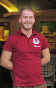 Portrait of young man working as waiter in Bar Fontana (Piceri Fontana) pizza restaurant in Shkoder, Albania.