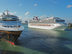 Carnival Splendor cruise ship and Disney cruise ship at dock in Port of Miami.