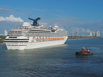 Carnival Splendor cruise ship assisted by tugboat leaving Port of Miami.