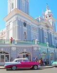 Restored American 1956 Chevrolet at Iglesias Catedral in Parque Cespedes in Santiago de Cuba.