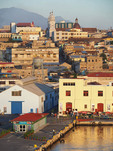 Dock of port of Santiago de Cuba with Iglesias Catedral at top.