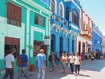 Colorful facades on pedestrain shopping street in Santiago de Cuba.