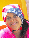 Young Afro-Cuban woman with American flag scarf in Santiago de Cuba.
