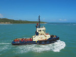 Tug boat Neptune based at Santo Domingo operating at port of Amber Cove in Domincan Republic.