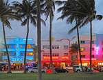 Art Deco District neon on hotels at dusk in Miami's South Beach.