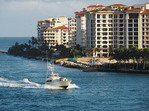 Yacht passing Fisher Island condos at Port of Miami.