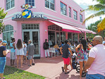 Customers waiting for tables at popular Big Pink restaurant in Miami's South Beach.