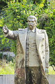 Weathered statue of Joseph Stalin stored behind library in Shkodra, Albania.