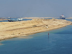 New section of Suez Canal with two way traffic, Queen Mary 2 headed north in right channel and oil tankers going south at left.