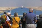 Cruise passengers watching Queen Mary 2 cruise ship in Suez Canal.  -Photo art painting