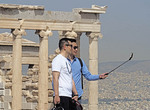 Tourists doing selfie at Acropolis in Athens.