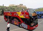 Athens tourist Hop On Hop Off sightseeing bus at Acropolis.