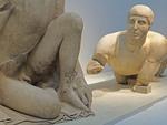 Sculpture of men in the Olympia Museum.