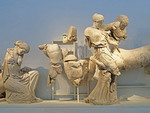 Battle of Lapiths and Centaurs sculptures from Temple of Zeus in the Olympia Museum.