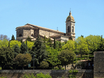 San Salvatore Roman Catholic Cathedral within the stone walls of the Tuscan hilltop town of Montalcino, Italy.