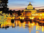 Evening view of dome of Saint Peter's Basilica in Vatican City and Ponte Sant Angelo over the Tiber River.