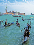 Gondolas on Venice lagoon with Church of Giorgio Maggiore in background.