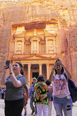 Two young women doing selfies at the Treasury facade in Petra.