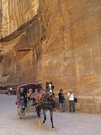 Horse-drawn carriage carrying tourists in The Siq at Petra.
