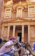 Tourist doing a selfie with camels at The Treasury in Petra.