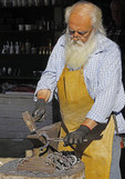 Blacksmith making horse shoes in Cetinje, Montenegro.
