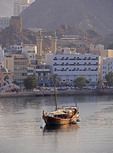 Traditional Arab dhow in harbor of Muscat, Oman.