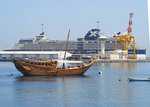 Port of Muscat with Arab dhow and cruise ship Celebrity Constellation