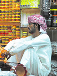 Shopkeeper in Muscat old town souk spice market.