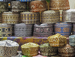 Oman caps.