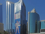 Abu Dhabi downtown with rocket man mural.