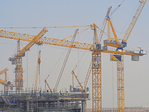 Construction cranes in Dubai, UAE.