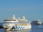 Cruise ships of the AIDA line, Aura and Stella, entering harbor of Civitaveccia, port for Rome.