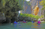 Canoes at James Bond Island (Ko Khao Phing Kan) in Ao Phang Nga National Park, Phi Phi Islands near Phuket, Thailand.