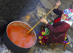 Woman cooking tomato sauce in Ribnovo village, Bulgaria.