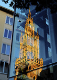 Munich Old Town Hall reflecting in glass elevator.