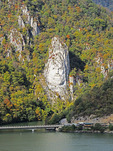 Head of last king of Dacia, Decebal (Decebalus) carved in stone on bank overlooking the Danube from Romanian side of river at Iron Gates gorges