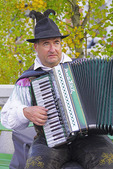 Accordion busker playing in Preseren Square in center of Old Town Ljubljana, Slovenia.
