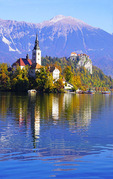Pilgrimage Church of the Assumption of Maria on Bled Island and Bled Castle high above Lake Bled, Slovenia.