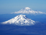Volcanic peaks of  Mount Adams and Mount Rainier (rear) in Cascade mountain range in state of Washington, USA.
