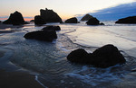 Sea stacks at dusk at Bandon Beach, Oregon, USA.