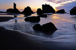 Bandon Beach sea stacks at dusk.