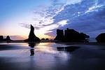 Sea stack rock formations at low tide at dusk at Bandon Beach, Oregon