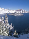 Fresh early winter snow on Wizard Island in Crater Lake, Oregon.
