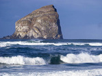 Haystack (Kiawanda) Rock with waves on beach at Cape Kiwanda, Pacific City, Oregon.