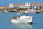 Tourists in water taxi in harbor of Oranjestad on Dutch Caribbean island of Aruba.