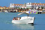 Tourists in water taxi in harbor of Oranjestad on Dutch Caribbean island of Aruba.