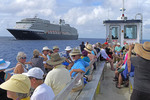 Passengers returning on a tender to the Holland America Line cruise ship Zuiderdam from Half Moon Cay in the Bahamas.