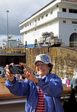 Cruise passenger doing selfie at the Gatun Locks of the Panama Canal.