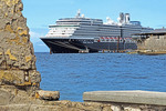 Holland America Line's Zuiderdam cruise ship framed by walls of old Fort Rif at entrance to Willemstad Harbor on Dutch Caribbean island of Curacao.