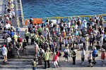 Passengers from Holland America Line's Zuiderdam cruise ship lined up to depart on shore excursions on the island of Curacao in the Dutch Caribbean.